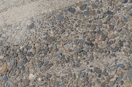 A pebble stone concrete surface walkway 版權商用圖片