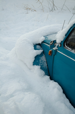 Cars buried in the snow