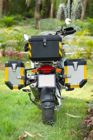 saddlebag: A rear view of big bike in the forest