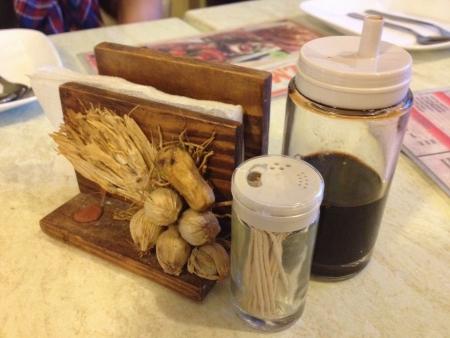 serviettes: serviettes, soya sauce and toothpicks on dining table Stock Photo