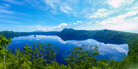 panoramic view of a lake reflecting sky. Lake Mashu,Akan National Park,Japan. Фото со стока