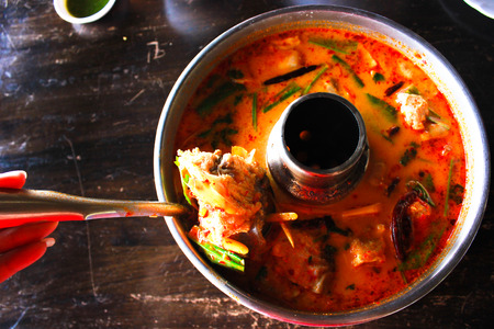resturant: This is a spicy soup with the head of a fish know as Tom Yum head fish. Its look crazy and it is very spicy. Stock Photo