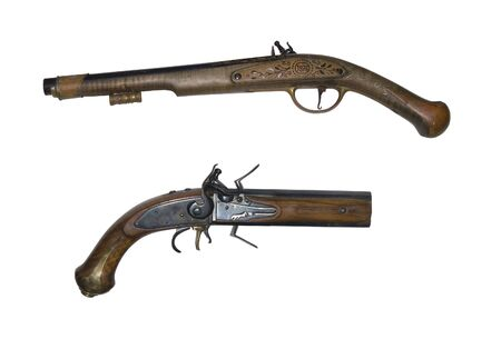 Old pistols isolated on white Stock Photo - 4864132