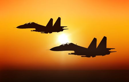 Jet fighters on sunset background