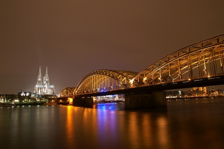 Cologne cathedral with Hohenzollern bridge at night Stock Photo