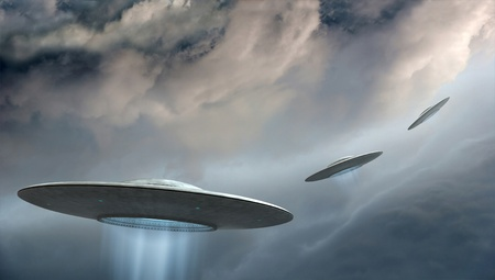 3d render of flying saucers ufo on dramatic clouds background  Archivio Fotografico