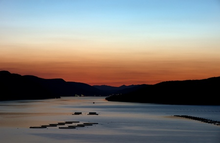 Sunset over Dospat dam situated in Rodopi montain, Bulgaria photo