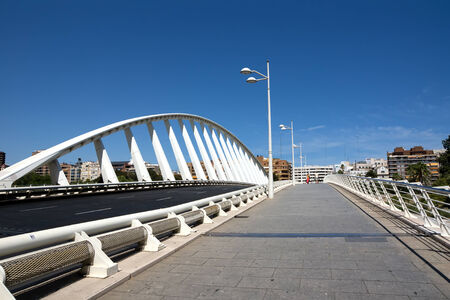 contributes: The Bridge of the Exhibition in city of Valencia, SpainValencia, Spain - August 12, 2013  The Bridge of the Exhibition also known as  Puente de la Peineta  refering to the shape of the arch that contributes to the stability of the structure, which is remi
