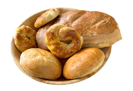 Bread rolls and loaf in bowl isolated over white background photo