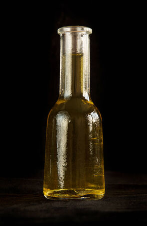 rakia: Traditional bulgarian small bottle for grappa on black background Stock Photo