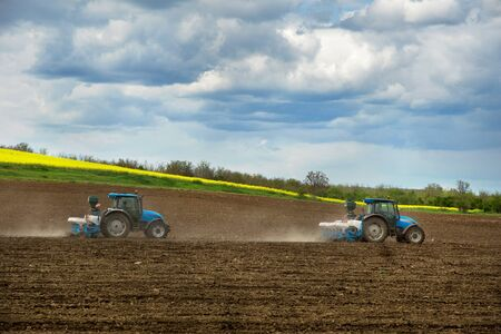 Farming a field with a tractors