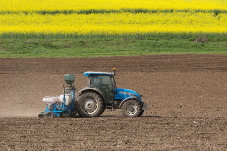 Farming a field with a tractor Stock Photo
