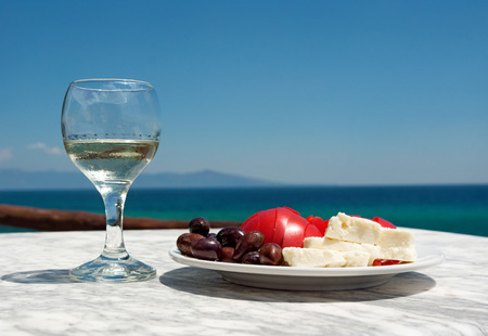 Appetizer and sallad on the sea background
