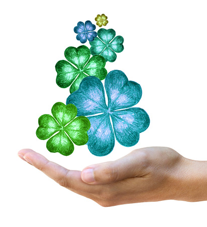 four leaf clovers: Conceptual image of hand drawn four leaf clovers over female hand