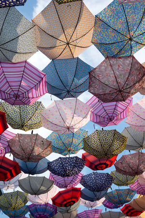 colourful sky: Colorful umbrellas flying in the sky