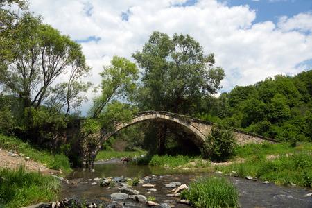 Old Roman bridge in Rodopi mountain Stock Photo