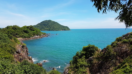 road bike: Scenic landscape wild nature tropical island with rocky mountains overgrown dense green jungle tree, of sea ocean at sunny day on background beautiful blue sky. Chanthaburi, Thailand.