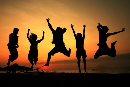 happiness people silhouette on the sunset: Silhouette jumping team
