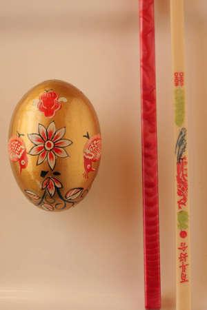 gold egg with chopsticks photo