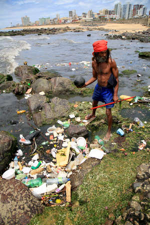 salvador, bahia, brazil - january 11, 2021: pollution and garbage on the Costa Azul beach in the city of Salvador. The material is drained into the sewage channel of the Rio Camurugipe and dumped into the sea.