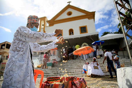 salvador, bahia, brazil - january 31, 2021: adherents of Candomble are seen during a sacred bath with popcorn in a religious ritual in reference to the orixa Omolu in the city of Salvador.