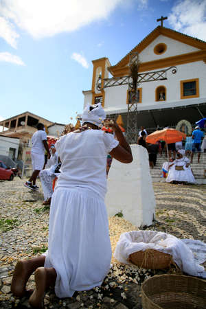 salvador, bahia, brazil - january 31, 2021: adherents of Candomble are seen during a sacred bath with popcorn in a religious ritual in reference to the orixa Omolu in the city of Salvador. *** Local Caption ***