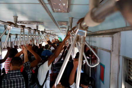 salvador, bahia / brazil - april 15, 2015: passengers are seen inside a train car in the suburb in the city of Salvador.