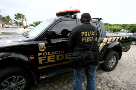 salvador, bahia / brazil - november 13, 2014: Federal police officers escort prisoners during a police operation in the city of Salvador.