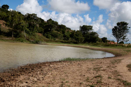 dam for storage of water for consumption of animals (cattle, horse) in pasture in the municipality of Conde.