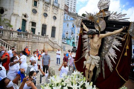 salvador, bahia, brazil - january 1, 2021: Image of Bom Jesus dos Navegantes leaves Nossa Senhora da Conceicao da Praia church and continues in a journey taken in a fire brigade vehicle through the streets of the city of Salvador.