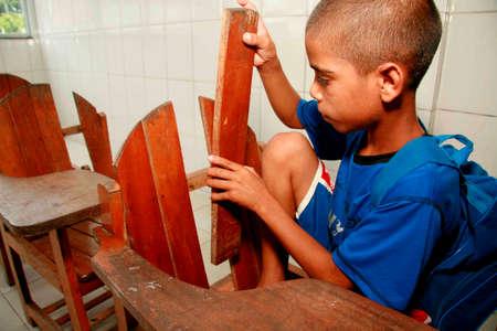 porto Seguro, bahia / brazil - september 3, 2010: Broken classroom moliliary is seen at Pero Vaz de Caminha school in the Paraguay neighborhood of Porto Seguro.