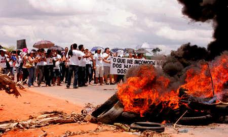 eunapolis, bahia / brazil - october 15, 2009: Teachers close BR 101 highway to protest the death of colleagues in ambush in Porto Seguro city.