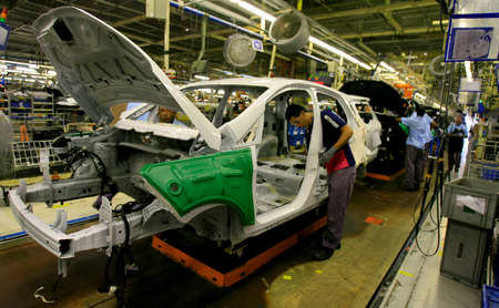 salvador, bahia / brazil - december 12, 2013: employees are seen at vehicle assembly line at Ford's Camacari factory. *** Local Caption *** Editorial