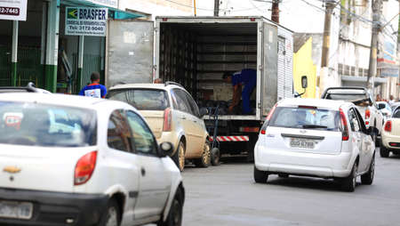 salvador, bahia / brazil - july 20, 2016: Cargo delivery truck is seen unloading orders in downtown Salvador.