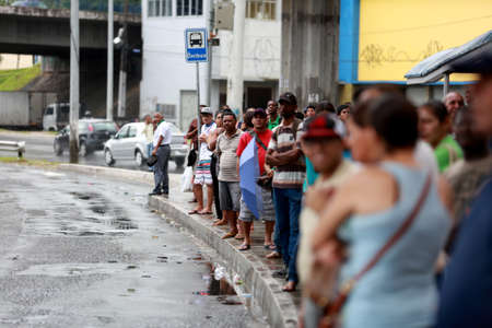 lauro de freitas, bahia / brazil - april 15, 2015: public transport passengers are seen waiting for buses due to drivers strike in the city of Salvador.