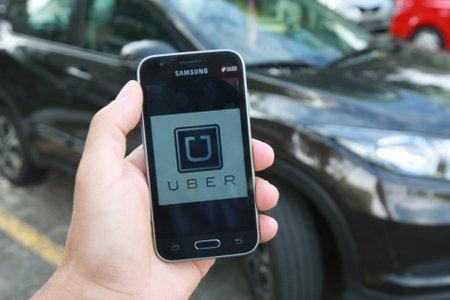 salvador, bahia / brazil - june 14, 2018: Uber driver application, passenger transport is seen in the city of Salvador.