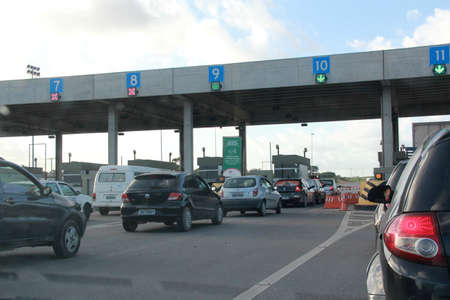 salvador, bahia / brazil - august 21, 2012: vehicles are seen in a toll line on highway BA 526 - Cia Aeroporto - in the city of Salvador.