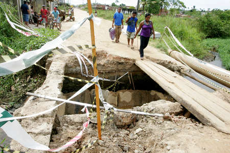 ilheus, bahia / brazil - mau 16, 2011: access bridge to the Coutos district in the city of Ilheus is seen destroyed after conflicts with local people.