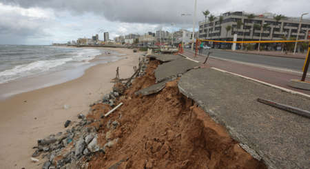 salvador, bahia / brazil - May 30, 2017: View of destruction caused by the advance of the tide on the pedestrian sidewalk in the Pituba neighborhood in the city of Salvador.