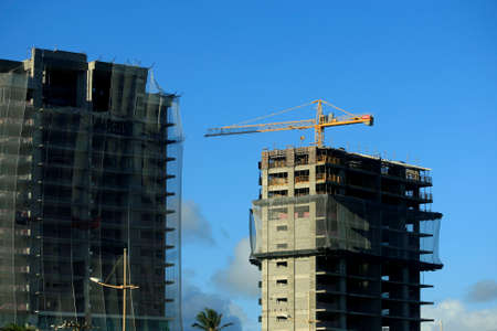 salvador, bahia / brazil - march 10, 2017: crane is seen in construction of residential building in the region of Piata, in the city of Salvador.