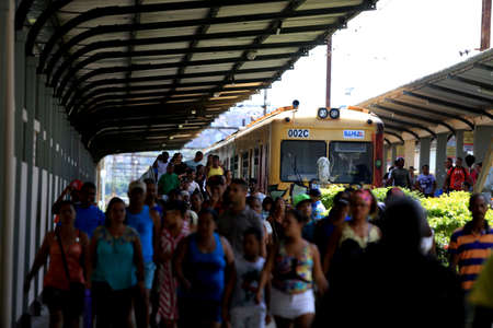 salvador, bahia, brazil - september 17, 2016: passengers are seen disembarking from a suburban train at the Calcada station in the city of Salvador.