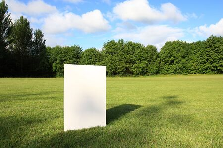 Big white blank card in a field Stock Photo