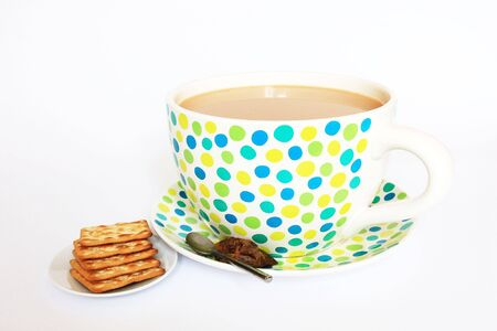 Very big tea cup and crackers Stock Photo