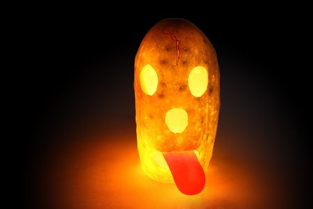 Glowing halloween cucumber, not pumpkin with red tongue Stock Photo - 7928848