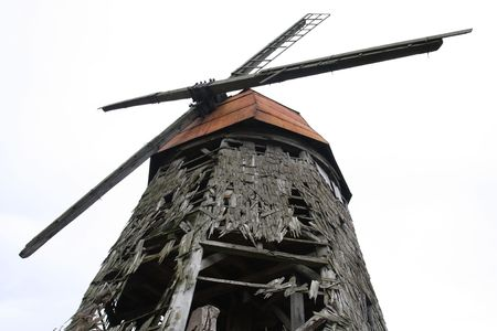 wind powered building: Old scary wooden windmill destroyed by natural forces