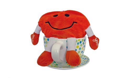 Funny red smiley face pillow in a big cup photo