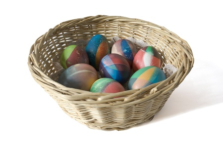 Hand painted traditional easter eggs in a basket isolated on white photo