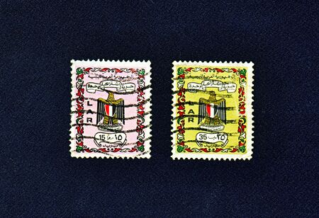 libyan: Two used Libyan Arab Republic postage stamps on black background