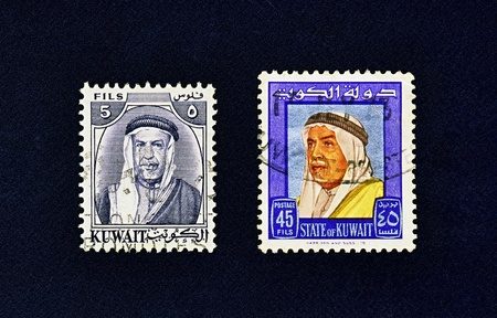 Two used postage stamps circa 1958 and 1964 showing portrait of Kuwaiti emir Shaikh Abdullah