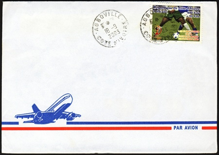 airmail: Blank air mail letter from Ivory Coast with football world cup stamp on it cancelled in Agboville
